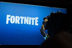 Tula, Russia - JANUARY 27, 2019 - Fortnite video game screen with character and console controller. Fortnight Battle. Royale online gaming by Epic Games stock photography
