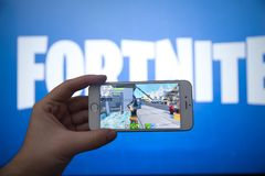 Tula, Russia - JANUARY 27, 2019 - Fortnite video game screen with character and console controller. Fortnight Battle. Royale online gaming by Epic Games stock image