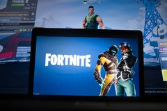 Tula, Russia - JANUARY 27, 2019 - Fortnite video game screen with character and console controller. Fortnight Battle. Royale online gaming by Epic Games royalty free stock image