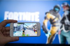 Tula, Russia - JANUARY 27, 2019 - Fortnite video game screen with character and console controller. Fortnight Battle. Royale online gaming by Epic Games stock images