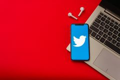 Tula, Russia - May 24,2019: Apple iPhone X with Twitter logo on the screen. On red background. - Image stock images