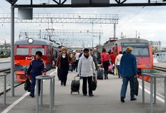 Passengers on the railway platform at the suburban electric trains at Tula station. Royalty Free Stock Photo