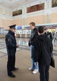 The police officer controls the public order at the railway station of Tula station. TULA, RUSSIA - SEPTEMBER 30, 2015: The police officer controls the public Royalty Free Stock Photo