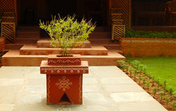 Tulasi kota a small podium like arrangement with holy plant in front of Hindu house Stock Photo