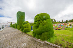 TULCAN, ECUADOR - JULY 3, 2016: the topiary located in the cemetery has many shapes representing some incaic sculptures Royalty Free Stock Photos