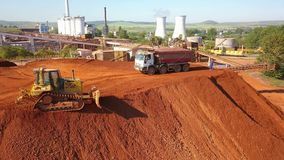 Aerial view of a ore deposit and alumina processing plant. Tulcea - Romania - June 01, 2019: Aerial view of a ore deposit and alumina processing plant stock video