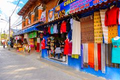 Achitecture of Oaxaca. TULE, MEXICO- OCT 31, 2016: Market place with the original traditional Mexican souvenirs and clothing, which are popular among the stock image