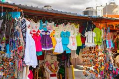 Achitecture of Oaxaca. TULE, MEXICO- OCT 31, 2016: Market place with the original traditional Mexican souvenirs and clothing, which are popular among the stock photo
