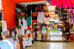 Achitecture of Oaxaca. TULE, MEXICO- OCT 31, 2016: Market place with the original traditional Mexican souvenirs and clothing, which are popular among the royalty free stock photography