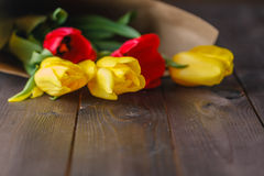 Tulip bouquet in craft paper Stock Image