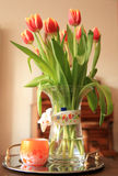 Tulip bouquet with happy birthday wish. A bouquet of tulips with a Happy Birthday wish and a candle royalty free stock photography