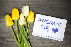 Tulip bouquet and notepad with Polish words I love you Stock Image