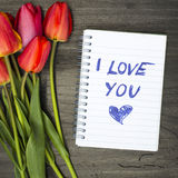 Tulip bouquet and notepad Stock Photo