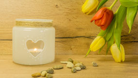 Tulip bouquet with a tea light. With heart Royalty Free Stock Images