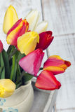 Tulip bouquet. On white wooden background Royalty Free Stock Photo