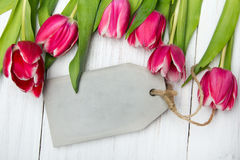 Tulip bouquet on white wooden background Royalty Free Stock Image