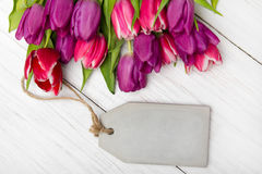 Tulip bouquet on white wooden background Royalty Free Stock Images