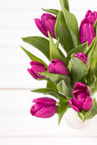 Tulip bouquet on white wooden background, copy space Royalty Free Stock Image