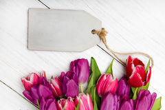 Tulip bouquet on white wooden background Stock Photography