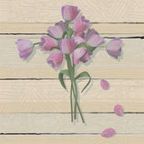 Tulip Easter Cross on a weathered wood background Royalty Free Stock Image