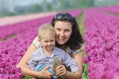 In Tulip Field. Mother with son in tulips field Royalty Free Stock Image