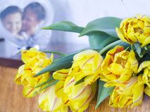 Tulip flower bouquet. Near the picture of couple Royalty Free Stock Photos