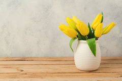 Tulip flower bouquet on wooden table over rustic background. Spring season Royalty Free Stock Photos