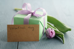 Tulip flower with green gift box and paper card on blue wood table for valentines day Stock Photo