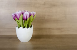 The tulip flowers against wooden background Royalty Free Stock Image