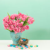 Tulip flowers and chocolate easter eggs Royalty Free Stock Images