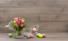 Tulip flowers and colorful easter eggs Royalty Free Stock Photos