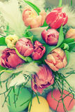 Tulip flowers and easter eggs. Floral arrangement Stock Images