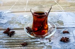 Tulip glass armudu with turkish tea blurred background royalty free stock photo