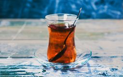 Tulip glass armudu with turkish tea blurred background stock images