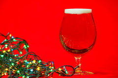 Tulip glass of beer with christmas lights Stock Image