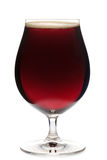 Tulip glass of dark ale beer isolated Stock Images