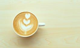 Tulip Latte Art. Beautiful tulip latte art on the table Royalty Free Stock Image