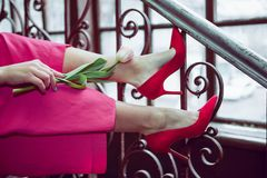Tulip in the legs of a young girl royalty free stock images