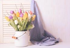 Tulipanes del color en el bastón Imagen de archivo libre de regalías