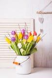 Tulipanes del color en el bastón Imagenes de archivo