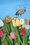 Tulipanes y abeja Fotos de archivo