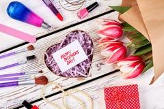 Tulipanes y accesorios de la belleza Fotografía de archivo libre de regalías