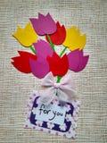 Tulipas coloridas de papel e uma inscrição para você fotografia de stock royalty free