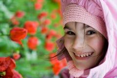 Tulipes de sourire d'enfant Photos stock