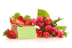 Tulipes et fraises roses Photographie stock