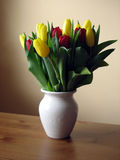 Tulips 2. Tulips in red and yellow in a white vase Royalty Free Stock Photos