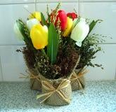 Tulips. Arrangement of tulips in a burlap bag Royalty Free Stock Photos