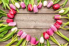 Tulips arranged on old wooden background Royalty Free Stock Photo