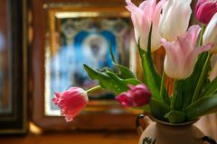 Tulips on the background of the icon, a red bouquet of tulips in a vase. Spring flowers royalty free stock photo