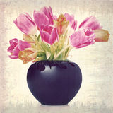 Tulips in a black flower vase Royalty Free Stock Photo